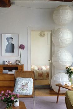 A stack of lanterns illuminates a corner of Vanessa Bruno's Paris apartment. Photograph by Birgitta Wolfgang Drejer. For instructions, go to Vanessa Bruno's Stacked Paper Lanterns. Paper Lantern Making, Paper Lanterns, Ikea Lanterns, Hanging Lanterns, Hanging Lights, My Living Room, Home And Living, Living Spaces, Interior Paint Colors