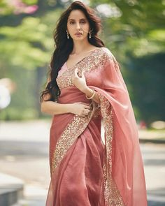 Nora Fatehi's desi saree avatar has left us speechless. She looked every bit regal in the rose-pink organza saree and we are reminded of the Rajput queens! Bollywood Girls, Bollywood Fashion, Bollywood Actress, Bollywood Celebrities, Bollywood Couples, Bollywood Saree, Pakistani Actress, Indian Celebrities, Bollywood News