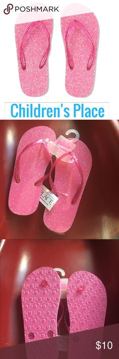 Pink Flip Flops Pink glitter infused & texture footbed. Pairs perfectly with swim wear. Size 1-2 NWT Pink Sold Out Online! Children's Place Shoes Sandals & Flip Flops