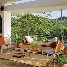 """The gazebo """"is a delightful place for an afternoon siesta,"""" says Solís Betancourt. Chairs, Henry Hall Designs. Perennials upholstery fabric on swing."""