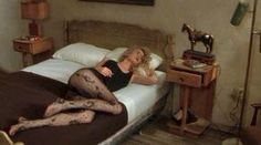 Laura Dern as Lula Fortune wearing crazy tights - Wild at Heart
