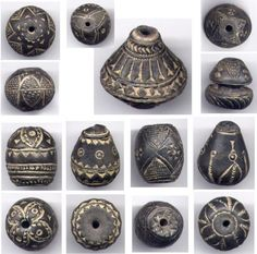 Some Examples of Carved clay beads from Mali. These beads are at least 100 years old. | Although often collected and strung as beads today, these spindle whorls would have originally been used to help spin thread. Made of clay and stone and incised with geometric patterns, they are recognizable by their enlarged central hole. Recent excavations in the old city of Djenne, Mali, show whorls to have been used since at least 1000AD.