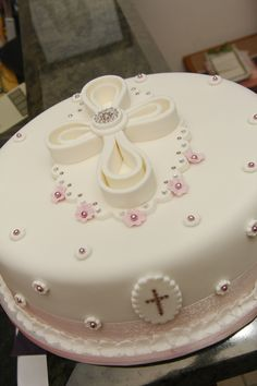 Christening I think this has to be my most popular design by far as I have made it 12 times now. however, I do love making the cross. Christening Cake Girls, Girl Baptism Cakes, First Holy Communion Cake, Pear And Almond Cake, Cupcake Cakes, Cupcakes, Religious Cakes, Confirmation Cakes, Occasion Cakes