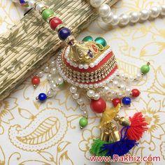Exclusively Designed Pearl Crafted Lumba Rakhi Send Rakhi To India, Buy Rakhi Online, Pearl Crafts, Rakhi Design, Diy Tassel, Online Gifts, Skirt, Pearls, Awesome