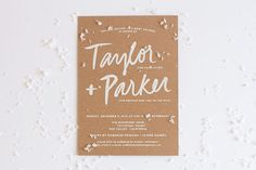 Simple style wedding invitation on brown card stock  - simple calligraphy
