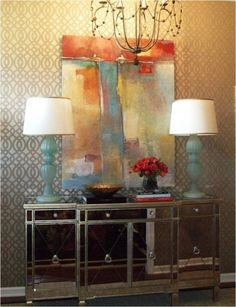 Love Tobi Fairley's modern entry with mirrored chest and abstract art