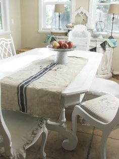 Would love to make some grain sack-like table runners from drop cloths painted with stripes!