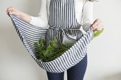 FEELING FINE: FOG LINEN APRONS AT FIELDWORK FLOWERS  Fieldwork Flowers florist Megan Arambul's work features an inspiring hard/soft balance, not unlike linen.  Though it's most often associated with quickly wrinkled summer wear, linen is one of the world's oldest fabrics, and startlingly tough. Fog Linen aprons feature a hefty fabric and minimalist cuts informed by Japanese design.
