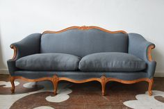 Our West Hollywood client asked us to find just the right antique sofa for her. We sanded the wood to its raw state & reupholstered it in Maxwell Fabrics's 100% linen textile, Barclay in Slate.
