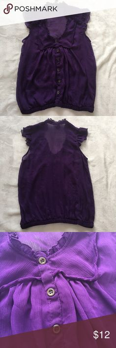 Sheer Purple Blouse Sheer sleeveless blouse with minimal ruffles detail. Fake button down detail. Elastic material at bottom of blouse. Tops Blouses