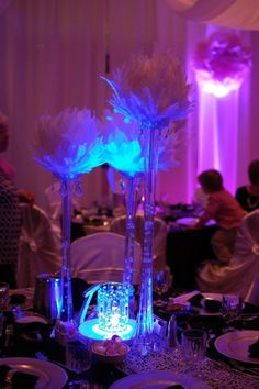 Wedding, Centerpiece, elegant events, lights, feathers, feather balls, Eiffel Tower vases, crystals, elegant, wedding, wedding decorations, party, elegant wedding, vase, decorations. Also on Facebook as Elegant events party rentals or www.weddingrentalsonline.com