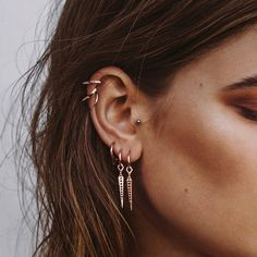 - Mini Hoop Earring with Hanging Spike Charm - Hoop is 12 MM - Hanging Spike is 27 MM - Plated Rose Gold - Made from Brass BACK IN STOCK APRIL 5! PRE-ORDER BELOW