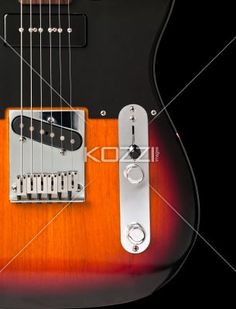 close-up shot of a electric guitar. - Close-up cropped shot of a electric guitar with strings and volume knob.