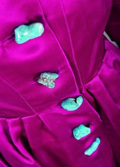 A rare Schiaparelli couture shocking pink coat-dress, late 1930s-early 1940s with detachable turquoise stone buttons