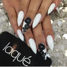 White Coffin Nails with Black Flowers. Enhance your look of your night date with your partner by adopting this amazing floral black and white studded nail art design.