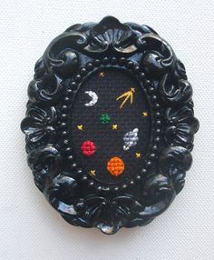 Spacey cosmos galaxy completed cross stitch in a small resin frame. ❥Obsessed with the new Cosmos series with Neil Degrasse Tyson, or a die heart Carl Sagan fan and lover of the old Cosmos series? ❥Space is crazy, huge, and overwhelming, and Ive captured it all in this tiny little cross stitch! --The Deets- This cross stitch features a bunch of teeny tiny things youd find in space; shooting star, moon, stars, and a few planets. Cross stitched on black 16 count aida cloth. Pick from...