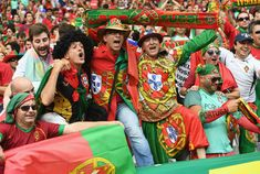 Portugal fans enjoy the atmosphere prior to the UEFA EURO 2016 Final match between Portugal and France at Stade de France on July 2016 in Paris, France. Uefa Euro 2016, We Are The Champions, European Championships, July 10, Portuguese, Paris France, Finals, Scarves, People