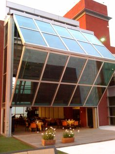 For the garage even?? Schweiss Glass Power Operated Lift Strap Bifold Door.