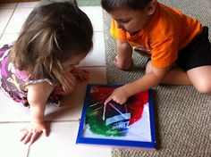 CLEAN FINGER PAINTING: With a 2 and 4 year old to teach, I am having to look for ways to aid their manual dexterity. Both kids know their colors, shapes, letters, and numbers so the natural progression seems to suggest that it's time for some writing practice. Here's a fun, neat way to practice over and over again.
