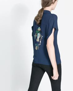 Love the embroidery on the back of this wrap blouse