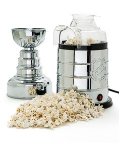 Celebrate with the revered Stanley Cup and plenty of popcorn during the hockey playoffs with this great NHL Stanley Cup Air-Pop Popcorn Maker. This detailed replica of the Stanley Cup opens up to become an air-popping popcorn maker. Hot Air Popcorn Popper, Air Popcorn Maker, Air Popped Popcorn, Air Popper, Hockey Playoffs, Blackhawks Hockey, Chicago Blackhawks, Stanley Cup, Hockey Room