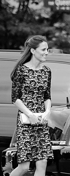 The Duchess of Cambridge on her first royal tour. Catherine landed in Canada wearing a beautiful Erdem navy lace shift dress. She finished her look with a chic half updo and her nude LK Bennett Sledge pumps.