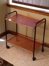 Our TV cart from the 60's, spray painted in sienna and espresso brown.
