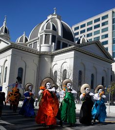 Participants walk the Day of the Dead procession from  City View Plaza to San Jose State in San Jose, Calif. on Sunday, Oct. 15, 2015. (Josie Lepe/ Bay Area News Group)