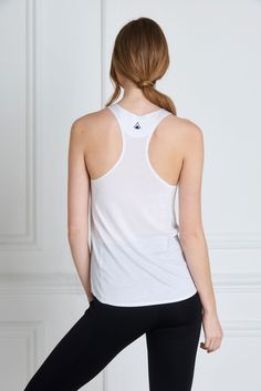 MARIA WHITE TANK - A faultless fit and soft, non-toxic jersey material make the Maria Tank a must have. The scooped racer back and high neckline front are impeccably assembled with bonded seams. A multipurpose piece, it can be worn from the markets to the Yoga mat, with many a tea date in-between.