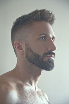 Blue eyed man with short hair from sides