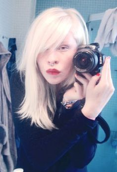 Connie Chiu is the first albino Chinese model with blue eyes and naturally white-blonde hair.