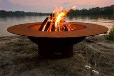 "The Magnum Wood Fire Pit with Lid by Fire Pit Art offers a high quality wood fire pit to elevate the ambiance of your favorite outdoor space. Designed as a larger version of the ""Saturn"" fire pit, the Magnum features a spectacular ring around the fire pit Fire Pit Art, Fire Pit Ring, Metal Fire Pit, Wood Burning Fire Pit, Diy Fire Pit, Fire Pit Backyard, Fire Pits, Fire Wood, Fire Pit With Lid"