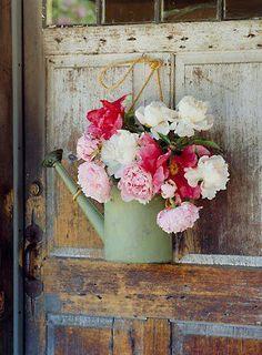 watering can bouquet on a rustic door ~ vintage green