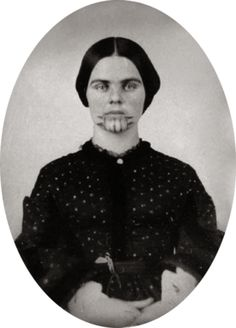Olive Oatman. Famously abducted by the Yavapai people then sold to the Mohave people. She is now popularized by the character in Hell on Wheels (etc). The significance of the tattoo was to identify her as a Mohave in the afterlife, thus the tattoo indicates that she was accepted fully into the Mohave tribe even though she did gain her freedom 5 years after capture.