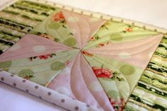 Sweet Dreams by Sarah love the quilting that turns half square t's into flowers