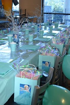 Frozen Homemade Party decorations. Wooden Branches for centerpieces were spray-painted and sprinkled with glitter.