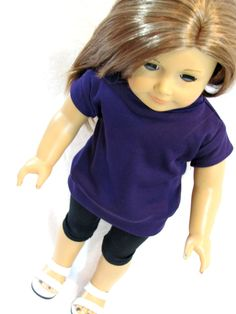 Our American Girl is all ready to go out with her friends in her purple mock turtle neck tunic and black leggings. Top is made with a poly/cotton blend jersey and closes with ultra thin, soft, flexibl