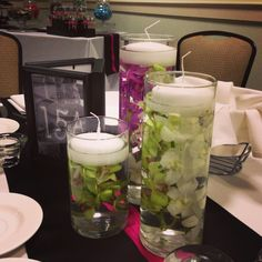 Cylinder trio of orchids and floating candles