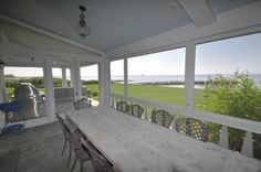 This fabulous screened-in porch is off both the dining room and the family room. What a view!!! -