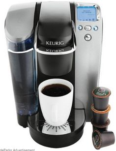 Keurig B70 Platium Brewing System - a single-cup brewer for home use with K-Cups.  It has an one-touch control panel with blue backlight LCD display of a digital clock.  There is a programmable on/off button, five brewing sizes, adjustable brew temperature.  It comes with a removable drip tray, a removable 60-ounce water reservoir for easy refilling; descale indicator; dishwasher-safe parts  measures 13-4/5 by 10-2/7 by 13 inches; For more info, visit bestcoffeemakermachinesonline.com