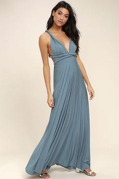 """Lulus Exclusive! Versatility at its finest, the Tricks of the Trade Slate Blue Maxi Dress knows a trick or two... or four! Two, 76"""" long lengths of fabric sprout from an elastic waistband and wrap into a multitude of bodice styles including halter, one-shoulder, cross-front, strapless, and more. Stretchy, jersey knit hugs your curves as you discover new ways to play with this fascinating frock. Full, maxi-length skirt has a raw hemline. Want Styling Tips? <a href='http:/..."""