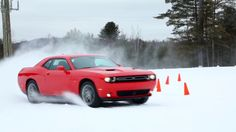 """Watch 2018 Dodge Challenger GT AWD Test Drive on Snow 4x4  The new 2017 Dodge Challenger GT all-wheel drive (AWD) delivers the performance power and all-weather capability to carve through some of the worst weather Mother Nature can dish out.  From winding through twisty stretches of mountain roads escaping away to a snow-covered ski resort to daily commutes through the slush and snow of Northeastern and Midwestern winters the Challenger GT AWD is built to handle it all.  """"Dodge is shifting…"""