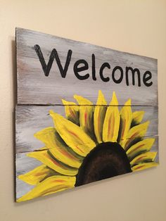 This is reclaimed wood from an old pallet. 11x14 Painted with a colorful sunflower . Spar varnish option is available to protect from the elements. Will make a great accent in the home or on the front porch. These are made as they are ordered. Due to the nature of the wood used texture and color can vary slightly. We have a 16x20 version also available in the shop.  Can also do these with another word over the sunflower. I am happy to take custom orders.