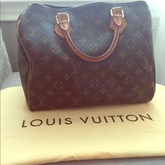 Louis Vuitton Speedy 25 Gorgeous and 100% authentic Louis Vuitton speedy bag in monogram canvas for sale. This is a pre-loved bag but in really good condition. The handles have some wear and have turned a warm honey, but there are no holes, rips or tears anywhere. Inside the bag, there is one small area that has a stain but a little cleaning could get this off. Comes with dust bag :-) I'd also like to note I don't smoke or have pets so my merchandise is odor free! Louis Vuitton Bags Satchels