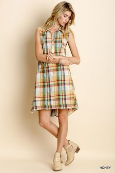 Plaid button up dress with hi-lo hem. Sweet with booties or sandals.  Layer with a cardigan for cool evenings on the beach or chilly winter  mornings. Or wear over leggings with high boots for Fall fun!