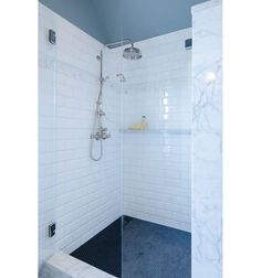 shower floor- black penny tile by Dal-Tile. Used with black grout helps keep the floor looking clean and stain free. Tile Shower Shelf, White Subway Tile Shower, Subway Tile Showers, Shower Floor Tile, Marble Showers, White Shower, Frameless Shower, Shower Niche, Blue Penny Tile