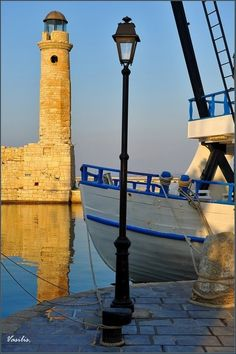 The lighthouse of the Venetian harbor of Rethymno is the second largest remaining Egyptian lighthouse in Crete, after the lighthouse of Chania harbor. It is built on the edge of the old sea wall of Rethymnon and it can be accessed very easily. Creta, The Places Youll Go, Places To See, Beacon Of Light, Greek Islands, Greece Travel, Albania, Beautiful Places, Around The Worlds