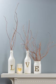 "Create ""Love"" Valentines Bottles using Montana Gold Spray Paint, recycled bottles and vinyl or sticker letters. Supplies available at Craft Warehouse"