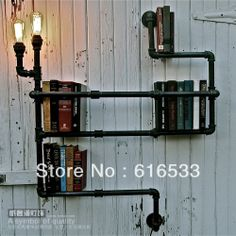 15 Industrial Pipe Furniture and Home Projects for DIYers Bookshelf Lighting, Pipe Bookshelf, Plumbing Pipe Shelves, Industrial Pipe Shelves, Bookshelf Design, Industrial House, Pipe Shelving, Shelving Ideas, Bookshelf Ideas