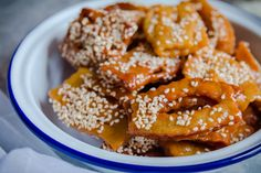 Chebakia, also known as mkharka, griwech or rose des sables is one of Moroccan cuisine's most delightful pleasures. It is a chewy, yet crunchy sesame, honey and turmeric wonderfully fragrant cookie. It has so many levels, you really have to try it to understand how amazing it tastes! Chebakia is com